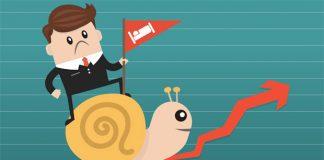 Businessman riding Snail slowly walk on arrow growth, performance
