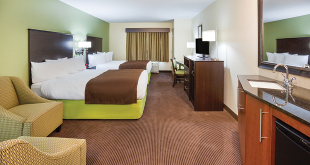 Queen double guestroom at AmericInn Hartford in Hartford, Wis.