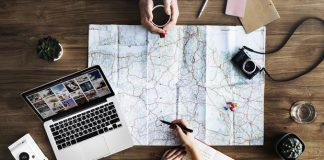 Laptop business travel planning, sharing economy