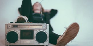 Woman listening to music on a radio