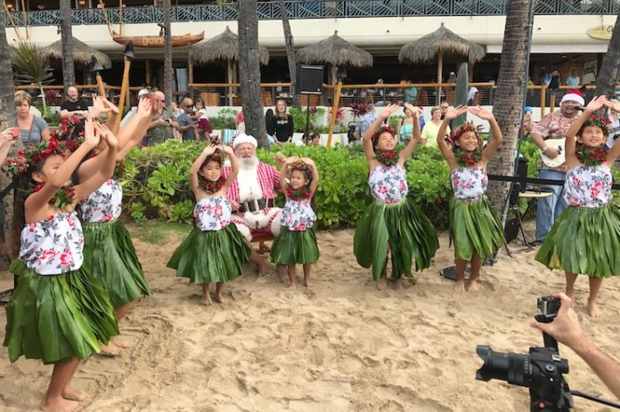 Santa will arrive by Canoe on Waikiki Beach on December 8.