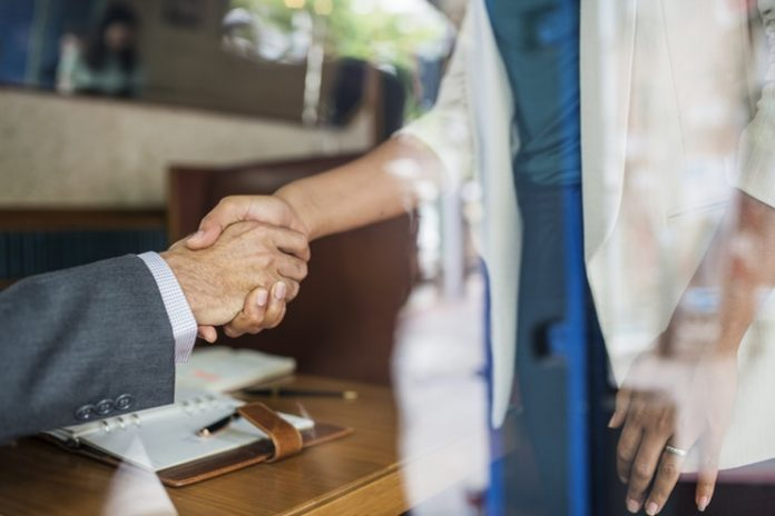 Professionals shaking hands - employee benefits