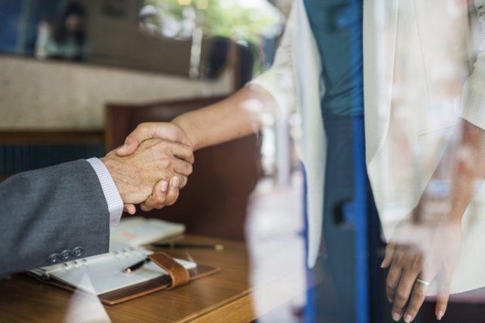 Professionals shaking hands - employee benefits