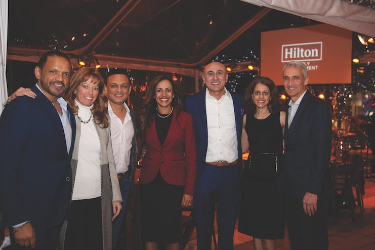 Anu Saxena (center) at the ALIS conference in January 2018 with other members of the Hilton leadership team.