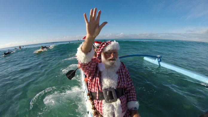 Santa arriving at Waikiki beach
