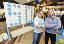 NSYNC member Lance Bass and Alexandra Jaritz, SVP and global head, Tru by Hilton, celebrate Tru by Hilton's growth to 50 open hotels with a giant CONNECT 4 tournament at Tru by Hilton Salt Lake City Airport. (Photo by Fred Hayes/Getty Images for Tru by Hilton)