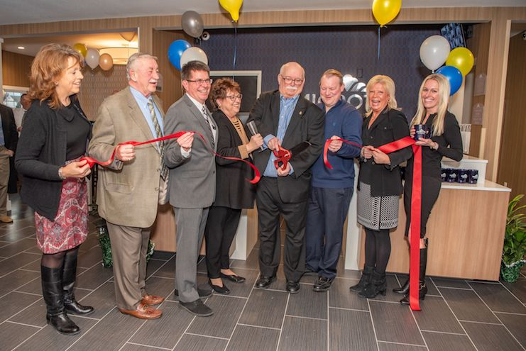 Hotel owners and community members celebrate the grand opening of Microtel Inn & Suites by Wyndham Carlisle on Westminster Drive, Wednesday, January 16, 2019. The newly-built, 80-room hotel offers guests an elevated hotel experience and economy price point with average daily room rates ranging from $79.00 to $119.00. Pictured from left to right are Michelle Crowley, president & CEO of the Carlisle Area Chamber of Commerce; Robert Yentzer, hotel owner; Robert Frey, primary hotel owner; Pam Fisher, sales associate at Berkshire Hathaway HomeServices; William Morris Kronenberg, hotel owner; Keri Putera, vice president, Brand Operations for Microtel by Wyndham; and Valerie Copenhagen, senior director, Marketing & Tourism, Cumberland Area Economic Development Corporation (CAEDC).