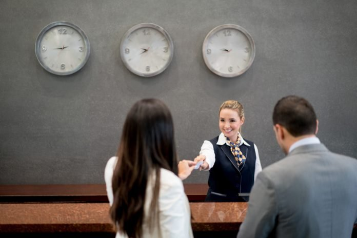Hotel staff front desk — employee retention
