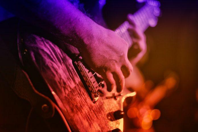 a musician plays a guitar at a concert