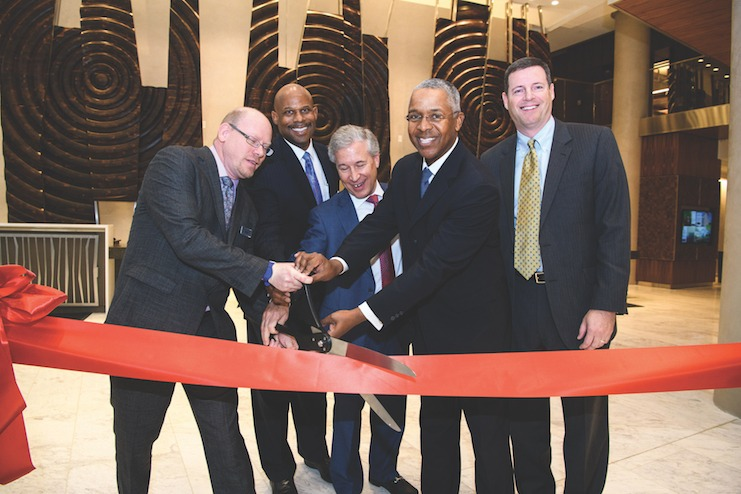 Jenkins helps cut the ribbon at the opening of the Courtyard and Residence Inn by Marriott Washington Downtown/Convention Center.