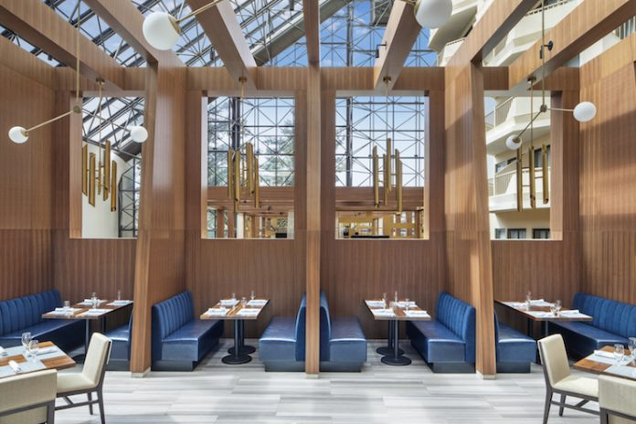 """Human-scaled """"rooms within a room"""" break up the atrium of DoubleTree by Hilton Hotel Newark Airport, creating intimate spaces for guests. (photo Villano Photo, courtesy LEO A DALY)"""