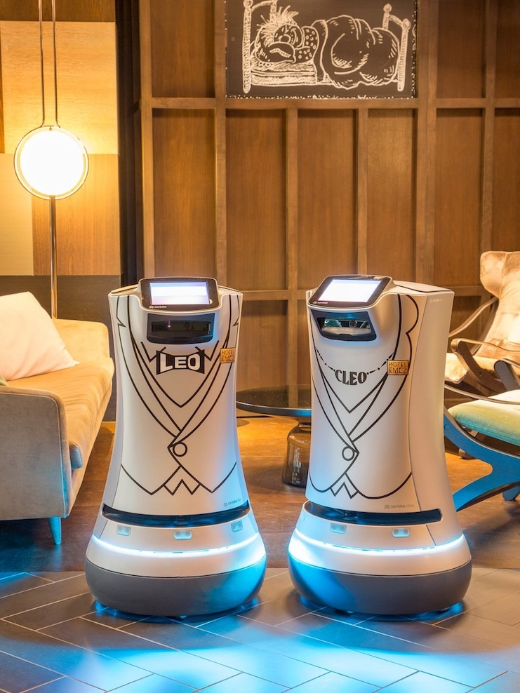Hotel EMC2's robots, Leo and Cleo, deliver amenities directly to guests' rooms.