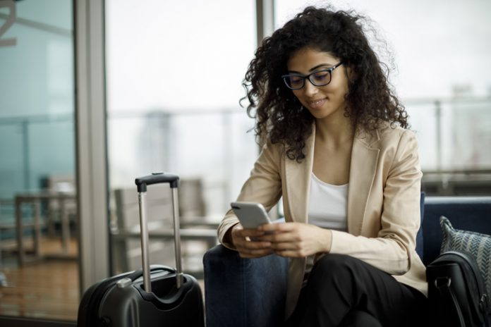 Business traveler using a hotel app