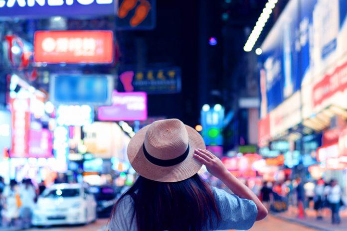 Tourist is visiting at Mong Kok night market in Hong Kong.
