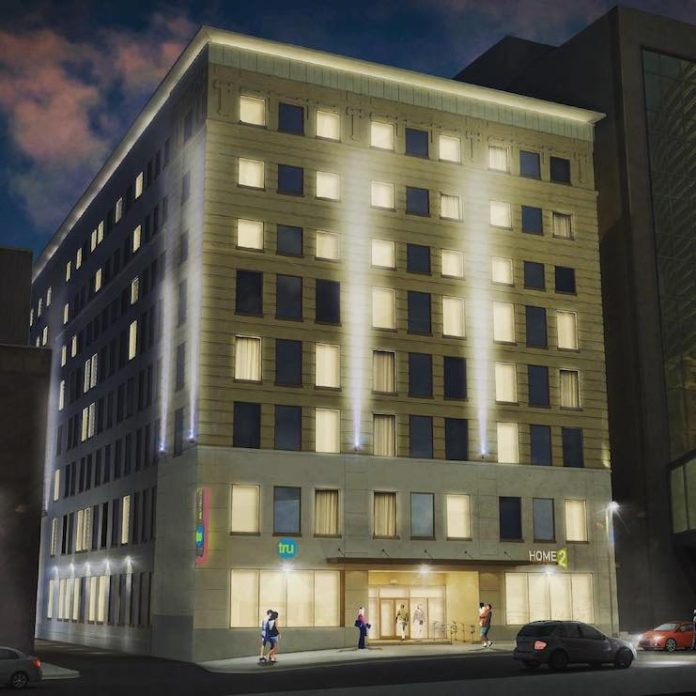 Iowa-based Hawkeye Hotels and Minnesota-based JR Hospitality began rehab on a dual-branded downtown hotel—the city's first Home2 Suites by Hilton and first Tru by Hilton.