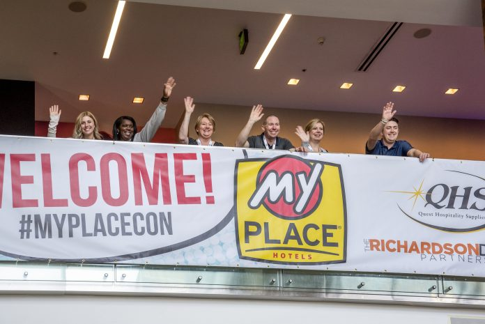 Attendees waving at the 2019 My Place Convention