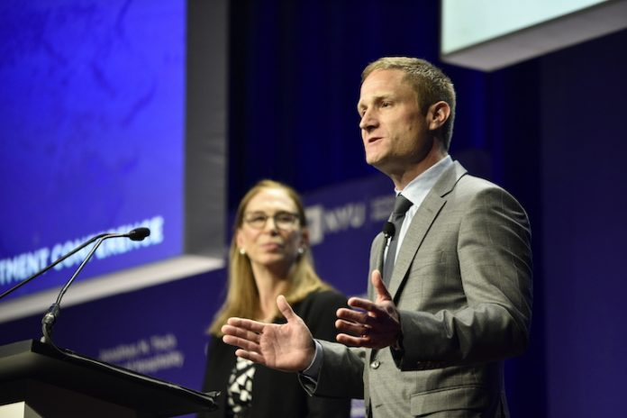 Nicolas Graf, associate dean of the NYUSPS Jonathan M. Tisch Center of Hospitality, announces a new scholarship program, while NYUSPS Interim Dean Susan Greenbaum looks on. (Photo credit: Tom Weis/NYUSPS)