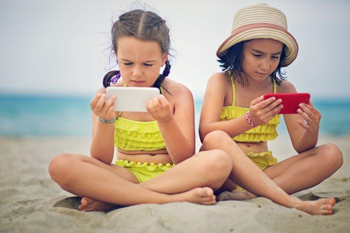 Digital detox - phones on the beach