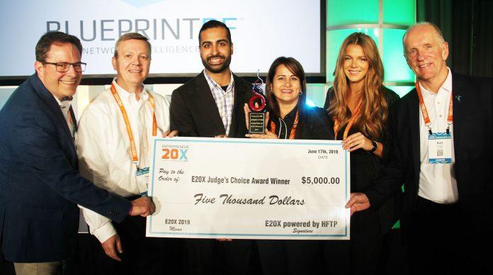 Parminder Batra (center right) receives the E20X Judge's Choice Award at HITEC 2019.