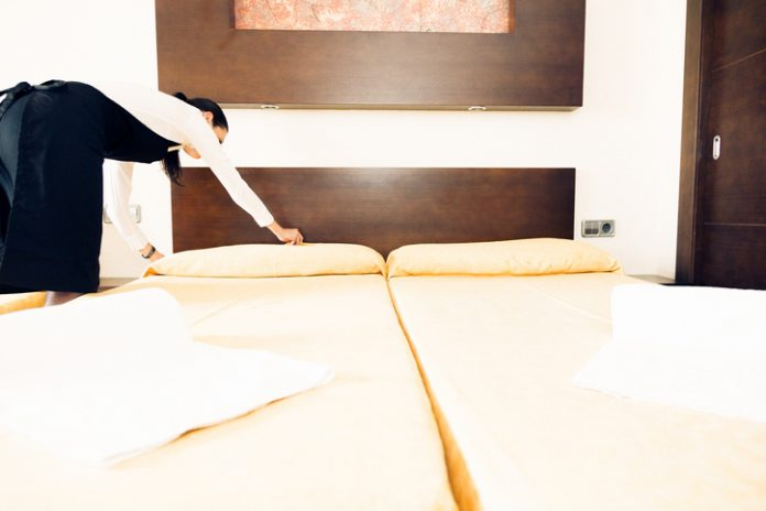 housekeeping inspecting for bed bug signs