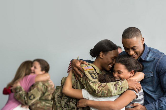 Country Inn & Suites partners with USO to reunite veterans and their families for Veterans Day