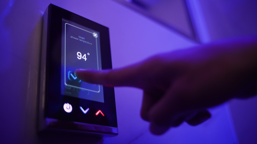 A guest uses a touchpad to set the shower temperature at The Sinclair hotel. (Credit: Sinclair Holdings LLC)