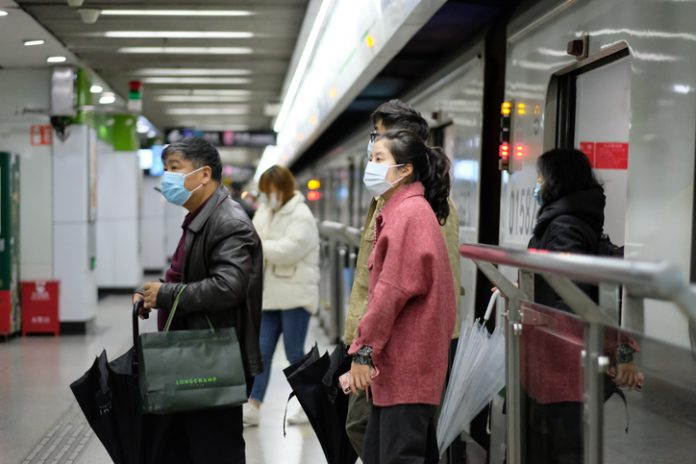 Shanghai/China-Jan.2020: New type coronavirus pneumonia in Wuhan has been spreading into many cities in China. People wearing surgical mask walking out from subway in Shanghai