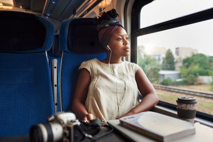 woman on train - sustainable travel
