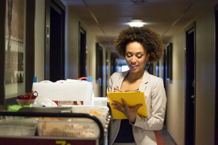 Women checks list during inspection