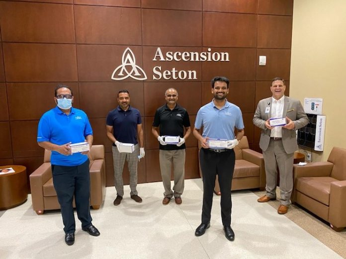 Neal Patel (second from right) of Blue Chip Hotels donates protective face masks at Ascension Seton Williamson Hospital in Round Rock, Texas as part of a 25,000 mask contribution by 12 hoteliers in four states.