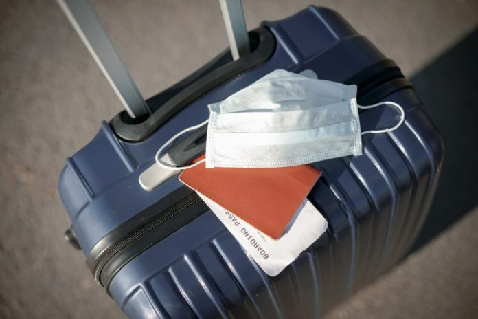 face mask suitcase travel - new norm