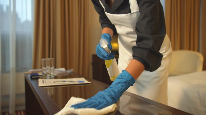 Room attendant cleaning guestroom