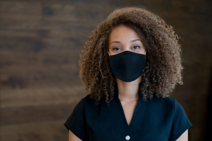 spa worker with face mask
