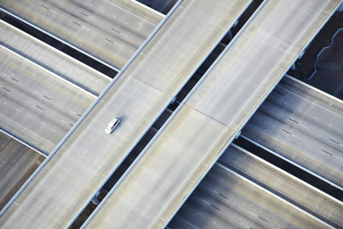 Empty highway with one car