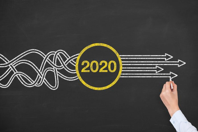 Person drawing arrows out of 2020 - solutions concept