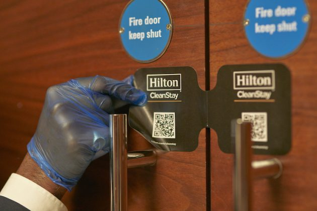 Team member places Hilton CleanStay Room Seal after full cleaning of ballroom at Conrad London St. James