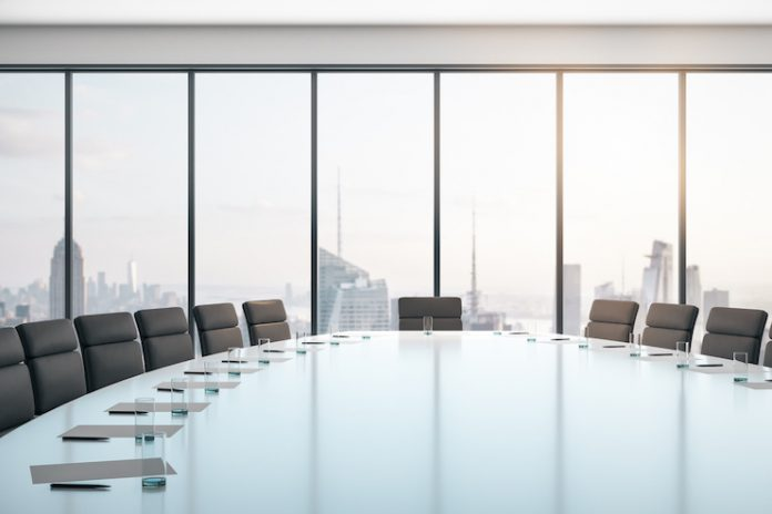 Photo of a boardroom, conference room with empty chairs — Diversity of boards concept: