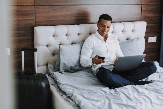 Business traveler uses multiple devices in a guestroom