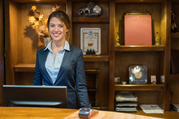 Hotel employee at the front desk