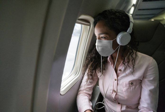 Traveling on an airplane wearing a face mask