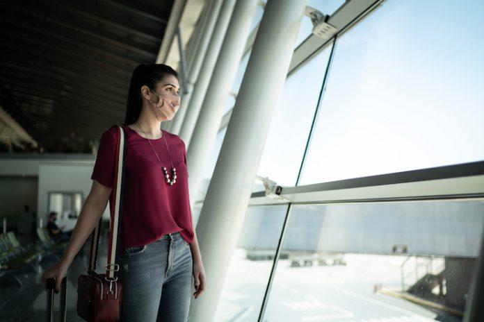 Traveler at airport wearing face mask