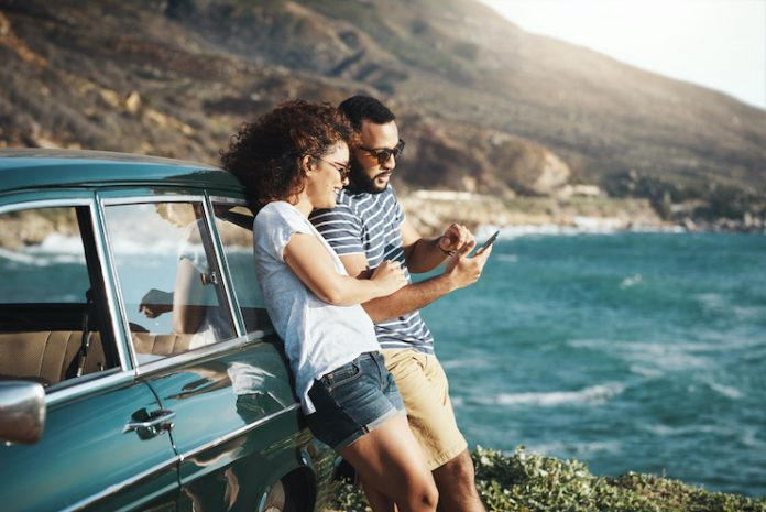 travelers on a roadtrip using their phone on vacation